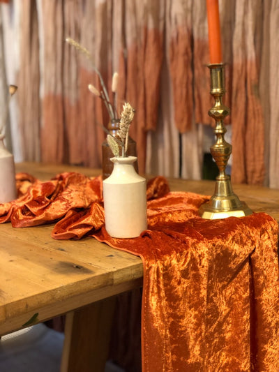 Table runner in burnt orange crushed velvet for hire by Rock the Day | prop hire | table and chair decor hire | event hire Essex, London, Hertfordshire