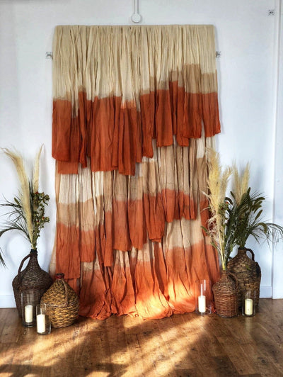 Bohemian photo backdrop for hire. We cover Essex, London, Hertfordshire. Party props, event styling, branding shoots, visual merchandising, interior design, backdrops to hire, furniture rugs and textiles to hire Rock The Day