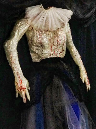 Bloody corpse in tutu skirt. Halloween party decorations, photoshoot props for hire in Essex, London, Hertfordshire.