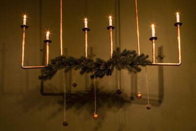 Christmas decor hire - copper pipe chandelier - style your Christmas with our props. Rock the Day in Essex