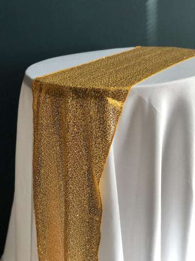 Gold Sequinned Table Runner. Looks really elegant on white table cloth. Essex wedding hire. Rock The Day