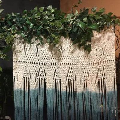 Handmade dip dyed green macrame backdrop for hire | macrame for hire Essex. Photo backdrop, party hire.