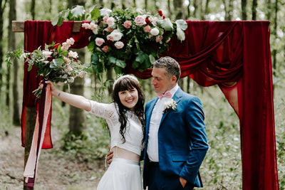 Burgundy drapes on rustic wooden arch for hire | backdrops for hire | party and event styling | Rock the Day Essex, London