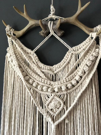 Macrame wall hanging on antlers/ Essex prop hire. Event hire, photoshoot props hire