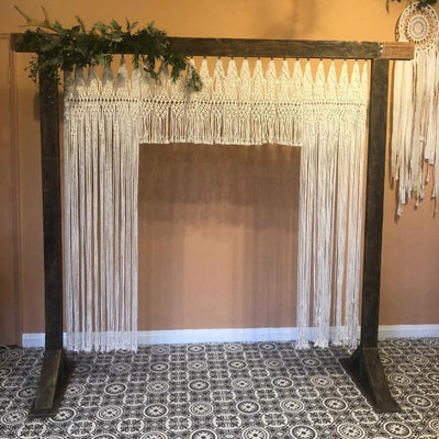 Wooden arch with macrame backdrop for hire