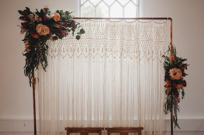 Macrame backdrop with copper pipe stand for hire | backdrops to hire | macrame hire London | Boho style parties and events, Rock the Day, Essex