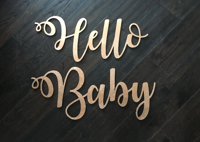 "Laser cut ""Hello Baby"" sign, hand gilded in gold or copper. Event hire, photoshoot props"