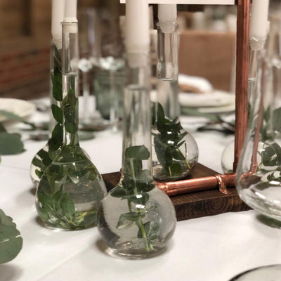 Glass bottles/Candle holders. Beautiful table decorations for hire/ photoshoot, parties, events