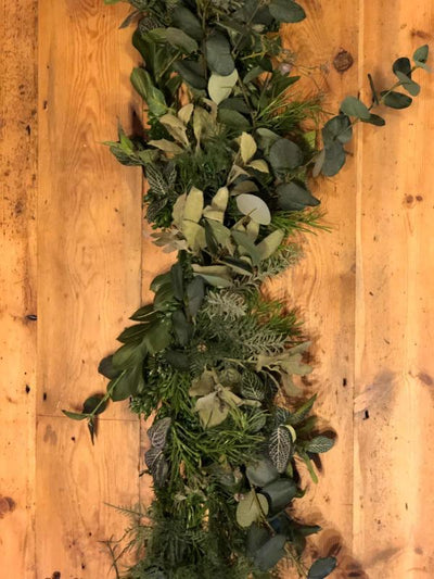Faux greenery garland for hire as party decor or photoshoot prop. Essex, London, Hertfordshire