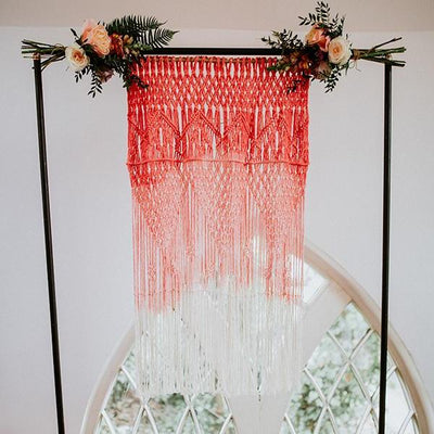 Handmade dip dyed in coral macrame backdrop. Photobackdrop, prop and decor hire | macrame for hire Essex