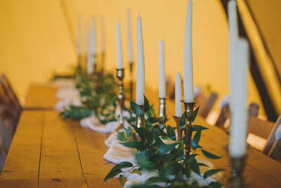 Brass candlesticks for hire, white chiffon runner with ruskus, table styling Essex