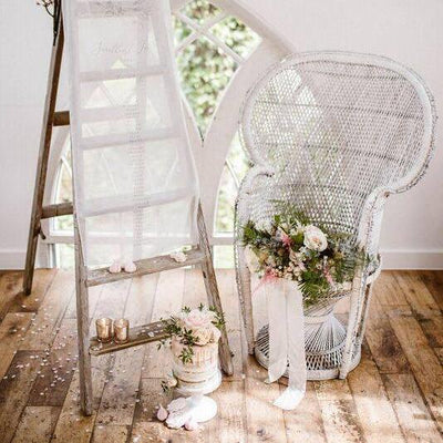 White Bohemian Style Peacock Chair for hire by Rock the Day, Essex