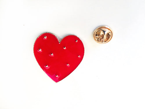 front view of red enamel heart pin