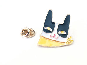 front view of black and white cat pin with yellow kerchief