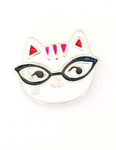 hard enamel pin with nerdy white cat with black glasses and hot pink ears