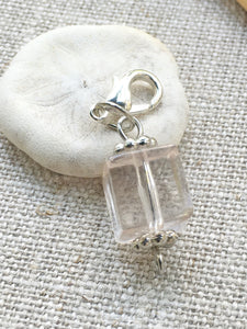closeup front view of clear acrylic square place holder for knitting and crochet