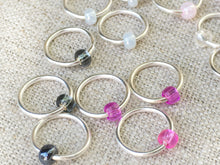 alternate view of pink and silver knitting stitch markers