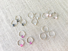 complete set of round pink white and silver knitting stitch markers