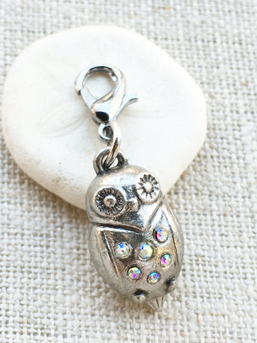 silver toned owl stitch marker with faux crystal beaded detail on front for knitting and crochet