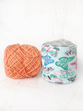 yarn bowl with multi colored butterfly on mint green cotton stretch fabric