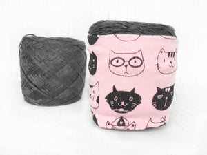 cat lovers skein coat on a ball of yarn versus a ball of yarn not covered