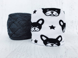 skein coat with black and white dog fabric shown covering a yarn ball