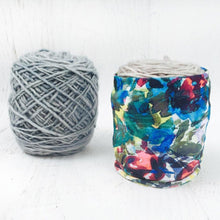 abstract floral Skein Coat in use covering the ball of yarn