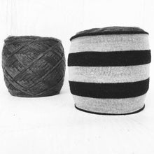 black and gray striped yarn cozy in use photo
