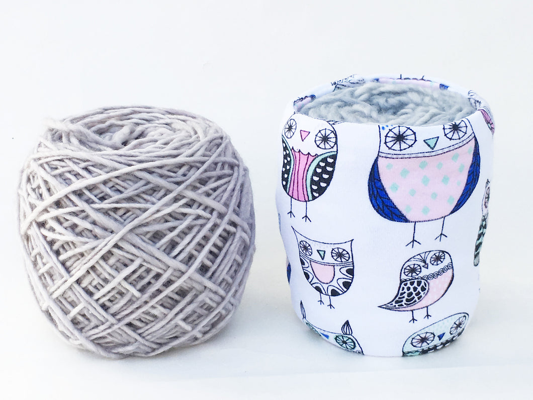 yarn covered with a skein coat versus an uncovered ball of yarn