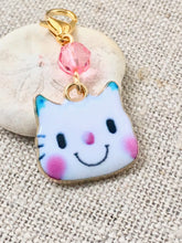 closeup front view of white enamel cat stitch marker for knitting or crochet