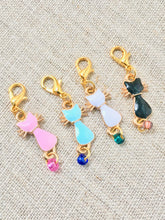 pink blue white and black enamel cats with gold toned details for knitting and crochet