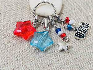 side view of patriotic stitch markers set for knitting and crochet