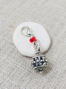 silver tone floral ball charm with red bead detail marker for crochet and knitting