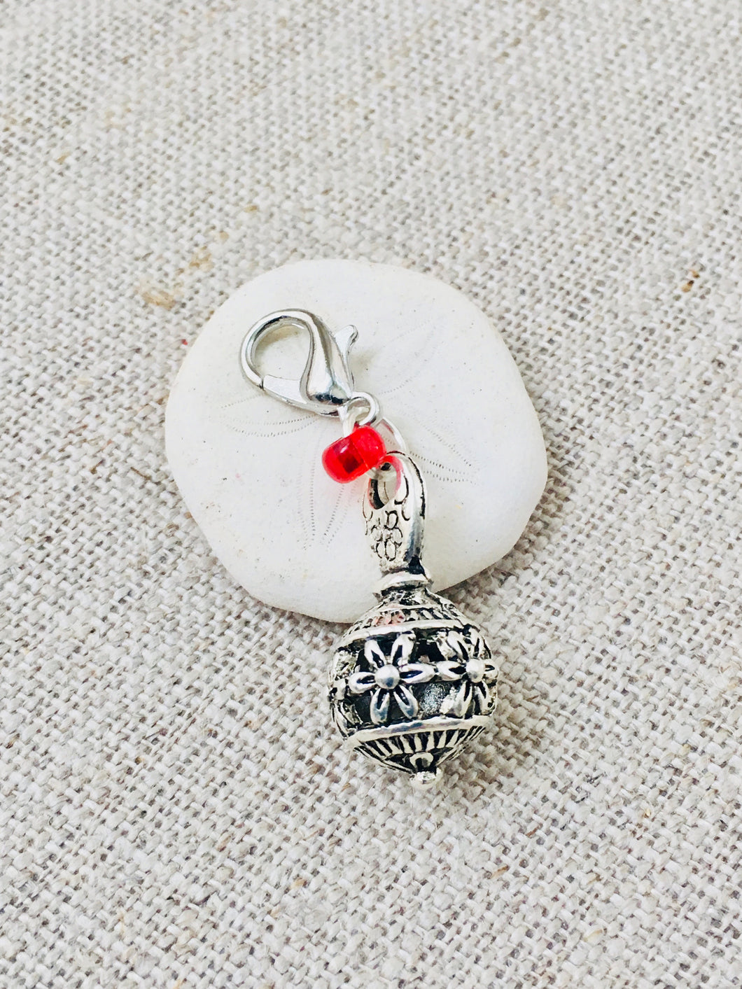 Tibetan silver ball stitch marker charm with red beaded detail and lobster claw closure
