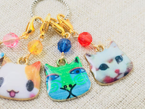close up view of enamel cat stitch markers for crochet and knitting