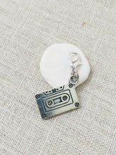 silver tone cassette tape crochet place marker close up view