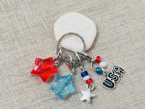 Patriotic set of stitch markers with include red, silver and blue stars with a silver tone USA charm