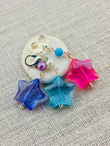 pink blue and purple star stitch markers with silver toned details