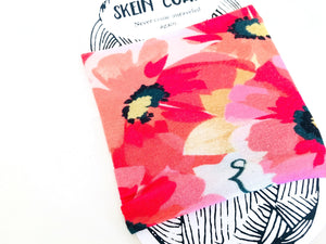 detailed view of the spring flowers that cover this stretchy cotton fabric