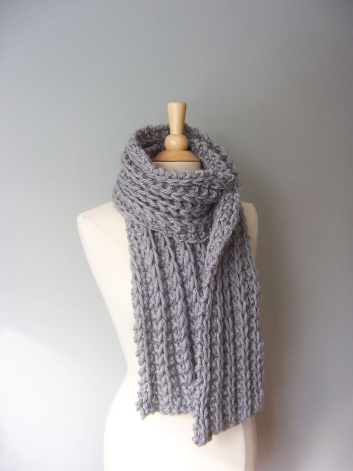 Bulky monterey scarf pattern shown in gray on a mannaquin