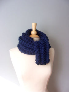 navy blue monterey scarf shown wrapped around the neck several times