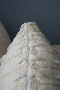 neatly knit seam finishing of the top of the cable knit sham