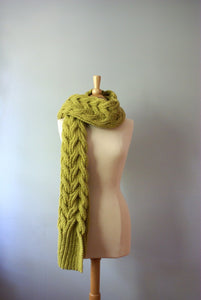 chunky aspen wrap being worn as a scarf thrown over your shoulder