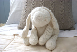 finished white fluffy dog toy made by this knitting pattern