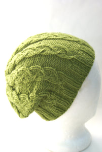 unisex cable knit hat pattern showing it worn slouchy
