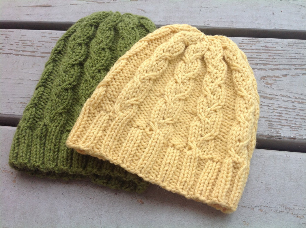 able knit hat shown in yellow and green