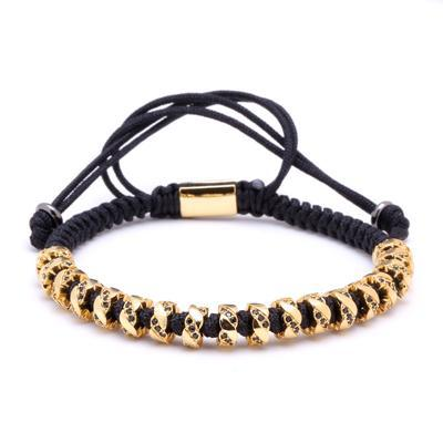 Luxurious macrame bracelet with gold plated copper and micro inlay black zircons.