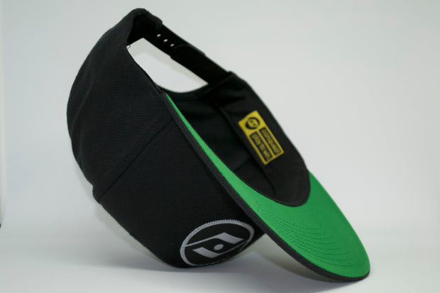 The obsession snap back (grey logo) green undervisor