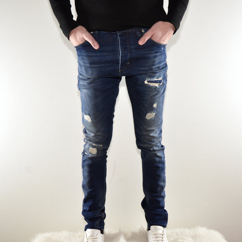 MID-WASH DISTRESSED DENIM