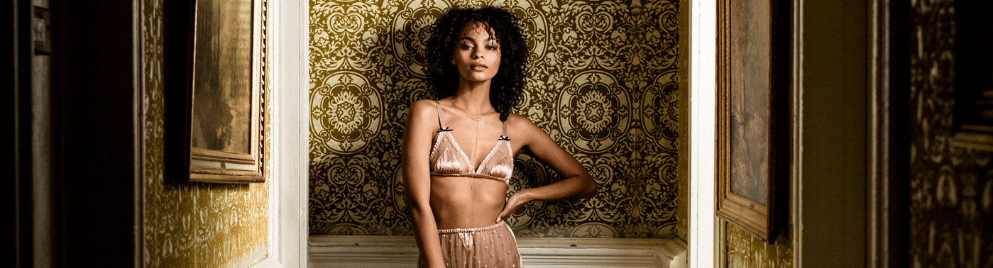 Fine vintage inspired silk lingerie with romantic pink silk bralette and tap pants